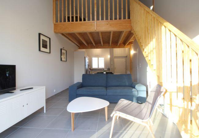 Appartement à Andernos-les-Bains - Confortable appartement T3 avec mezzanine en plein centre-ville, proche de la plage
